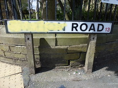 Road (The Chairman 8) Tags: road sign yellow wall paint yorkshire streetname stationroad queensbury