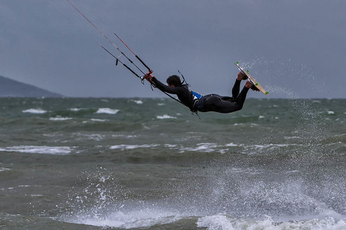 Kite surfer jumping horizontal