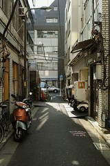 (sandman_kk) Tags: road street urban japan buildings tokyo vanishingpoint wire alley path cable scooter delivery 2013