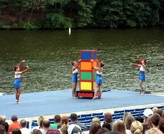 Performing An Illusion On Stage. (dccradio) Tags: trees ladies girls red vacation lake tree tourism water wisconsin river pond women box stage magic tourist illusion greenery boxes trick wi wisconsindells dells whiteblue lakedelton bodyofwater thrillshow tommybartlettshow coloredboxes