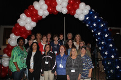 Women Pose beneath a Patriotic Arch (Ohio Department of Veterans Services) Tags: friends ohio woman army coast women shrine force vet air guard navy center conference oh service served marines aladdin forces veterans attendees armed vets attendee comraderie 2013