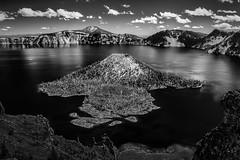 Wizard Island (StefanB) Tags: sky bw lake water monochrome clouds oregon landscape island nationalpark craterlake geotag wizardisland em5 1235mm flvonmirikr