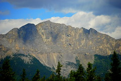 RUGGED MOUNTAIN PEAKS.....THE CANADIAN ROCKIES,  ALBERTA. (vermillion$baby) Tags: banffday rockformation rockymountaineer banffgondola blue cloud granite green mountain peak rock stone tree banff mountainpeak canadianrockies landscape bc canada traintrip vista trees