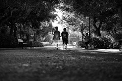park street trees light sky blackandwhite bw monochrome kids 35mm walking children mono shadows candid streetphotography ground greece crete groundlevel bwphotography rethymno whiteandblack groundview candidphotography streetphotographer ratseyeview sonynex nex6 sel35f18 sonynex6 streethunters