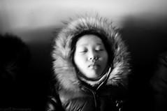 睡梦中的女孩,哈尔滨。 (SinoLaZZeR) Tags: life china street winter people blackandwhite bw snow ice heilongjiang river children blackwhite asia fuji streetphotography photojournalism documentary streetlife finepix fujifilm 中国 冬天 雪 黑白 harbin reportage 女孩 northeastern 纪实摄影 haerbin songhuajiang 女 松花江 哈尔滨 孩子 zhongguo 冰 东北 黑龙江 x100 睡眠 songhua 亚洲 yazhou dajie 中央大街 街头摄影 zhongyang 冰城 zhonggyangdajie