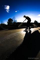 Backside 50-50 Silhouette (KyleSealPhotography) Tags: life park rose canon kyle lens photography is skateboarding board nick slide professional telephoto skatepark seal skate 7d skateboard l skater 28 trick 70200 5050 blunt f28 skates skateboarder rec vibrance llens bluntslide