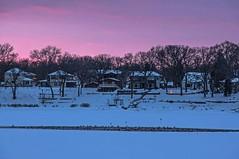Crystal Lake Sunset (Doug Wallick) Tags: winter sunset lake snow ice minnesota crystal sony ducks heated lightroom robbinsdale a55