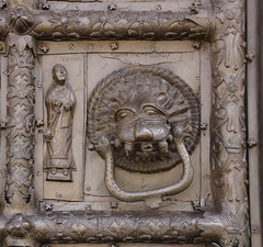 A Priest (left) and a Leocephal with Sinners in its Jaws (right) (Sergei P. Zubkov) Tags: church june bronze doors cathedral russia gates magdeburg romanesque orthodox sophia stsophia 2013 velikiy novgorod