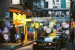 The City's Waiting (Hayden_Williams) Tags: street city light man streets cars film bar night analog canon vintage hongkong lights exposure kodak ae1 bokeh doubleexposure grain hipster double hong kong 100 grainy date expired ektar