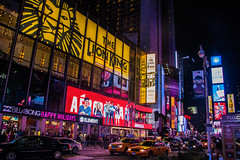 Times Sq, New York (andyrousephotography) Tags: christmas city nyc decorations newyork yellow architecture night buildings landscape cityscape cab taxi broadway nighttime timessquare bigapple skyscaper yellowtaxi 5thaveune