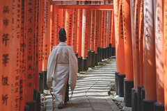 Down the Torri Tunnel (Nora & Valdas) Tags: japan kyoto inari tunnel priest shinto torri taisha fushimi