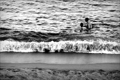 waves of brotherhood (bostankorkulugu) Tags: barcelona friends sea blackandwhite bw white black beach water monochrome sepia blackwhite spain sand couple europe mediterranean waves friendship fraternity catalonia barceloneta catalunya brotherhood bostanci decisivemoment bostan korkut espanya barcelonetabeach bostankorkulugu