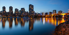 Vancouver`s Lights (Clayton Perry Photoworks) Tags: blue panorama canada skyline night vancouver buildings reflections lights bc falsecreek cambiestreetbridge hirises explorebc explorecanada