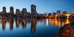 Vancouver`s Lights (Clayton Perry Photoworks) Tags: blue panorama canada skyline night vancouver buildings reflections lights bc falsecreek cambiestreetbridge hirises explorebc explorecanada