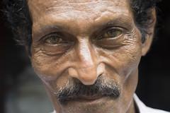 Eyes of Sri Lanka (Photosightfaces) Tags: portrait man face eyes moustache sri lanka srilanka srilankan lankan