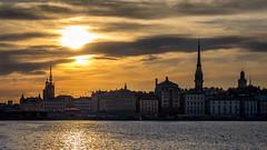 Sunset over Stockholm (Jens Haggren) Tags: olympus em1 sun sunset sky clouds city cityscape buildings water gamlastan oldtown stockholm sweden