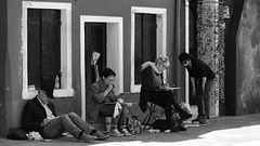 Painting Burano (Just Ard) Tags: street venice people blackandwhite bw woman man blancoynegro monochrome painting person photography mono nikon artist sitting noiretblanc zwartwit candid painter d750 unposed  bianconero burano 24120mm schwarzundweis justard