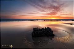 Amanece (Caramad) Tags: sea espaa seascape color sol sunrise landscape mar agua rocks playa amanecer olas rocas cantabria noja trengandin marcantbrico camadats