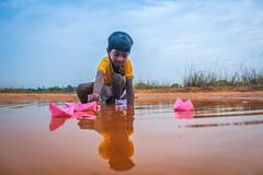 (  - Paper Boat) (VENGAT SIVA) Tags: travel rain childhood clouds rural traditional streetphotography games monsoon childrens roadside tamil climate tamilnadu pondicherry roi streetplay aattam rootsofindia aadukalam