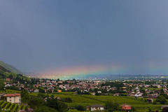 Rainbow or Rain-low? (photobrixie) Tags: sky green colors rain landscape evening rainbow vineyards