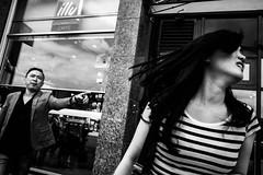 Stop her (Georgios Karamanis) Tags: street people bw woman white man black window netherlands amsterdam finger pointing karamanis