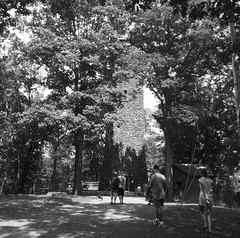 Approaching the Tower (pilechko) Tags: trees people blackandwhite sunlight tower monochrome shadows pennsylvania newhope bowmanshill