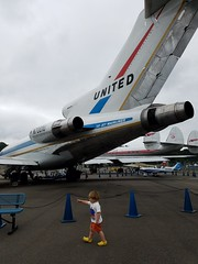 Small kid, big plane (quinn.anya) Tags: 747 boeing jet united pointing airplane toddler