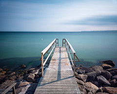 Where the Eels Are (claustral) Tags: longexposure summer sunlight water coast pier woods rocks sweden jetty ven resund 2016 i500 interestingness211 labodarna explore20160628