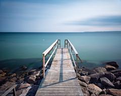 Where the Eels Are (claustral) Tags: longexposure summer sunlight water coast pier woods rocks sweden jetty ven öresund 2016 i500 interestingness211 ålabodarna explore20160628