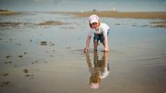 Twice the fun. (whooosh.) Tags: sea playing reflection girl coast kid sand mud north dirt shore 169 pellworm waddensea nortsea