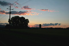 (Miss Marisa Renee) Tags: road pink blue trees sunset sky nature field car silhouette digital canon landscape outdoors colorado pretty driving purple farm pastel horizon silo powerlines roadside shoulder silhouetted telephonewires canon400d canoneosxti marisarenee