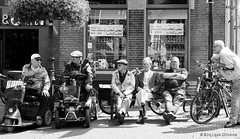 hangouderen / loitering (MoniqueDK) Tags: pet men bike bicycle bench candid streetphotography bank cap elderly ouderen fiets odc mannen scootmobiel hangouderen straatfotografie gallgall scootmobile moniquedk moniquedkoens