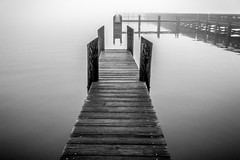 Black, White and Beyond (cparker321) Tags: park county bw white black reflection water fog photoshop canon river dark eos rebel coast pier wooden dock view florida ominous infinity space foggy lagoon adobe short reflective forboding t3 53 wavy lr brevard lightroom spaceview spacecoast 1100d