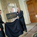 Thomas and then Chancellor Woodward unveil a ceremonial plaque of the building dedicated in his name.