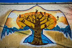 Vancouver Jan 14 - Community Tree (Ted's photos - For me & you) Tags: blue shadow tree bird art wall vancouver mural branches wallart bluesky dedos publicart cinderblock raven vignetting roofline treebranches vancouverbc treeoflife xochitl wallmural vancouvercity tedsphotos stylizedtree streetpassionaward nomadicalternatives nomadicalternativesorg