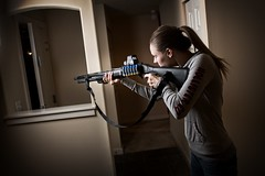 girl shooting shotgun selfdefense remington intruder girlswithguns versamax mesatactical shotgunaccessories mohawkforend sureshellcarrier urbinostock