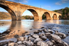 Telfords Bridge (Daniel Giza) Tags: bridge light sunset sun white black reflection water rock architecture canon river landscape scotland arch outdoor perthshire viaduct tay column dunkeld telfords 50d
