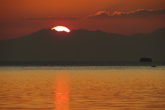 beyond the sunset (DOLCEVITALUX) Tags: sunset sea sky water clouds reflections bay ship outdoor philippines scenes sunsetscene canonpowershotsx50hs sunsetscenessea