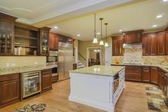 stained-white-kitchen-cabinets-tile-backsplash-remodel-remodeling-home-sebring-services (sebringservices) Tags: white home kitchen stained granite remodel luxury cabinets remodeling hardwood