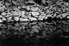 Boulder Shoreline (Orbmiser) Tags: bw oregon portland spring nikon rocks riverbank willametteriver eastbank d90 55200vr