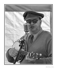 Colin Bourdiec (Seven_Wishes) Tags: uk portrait people blackandwhite bw musician sunglasses reflections person mono md uniform ukulele outdoor banjo monochromatic nostalgia northumberland cap singer ww2 microphone hh entertainer kc gs reenactment reenactor worldwar2 newcastleupontyne blyth impersonator georgeformby banjolele tyneandwear jdo edoliver ensa photoborder blythbattery 7wishes canoneos5dmark3 colinbourdiec newcastleupontynenortheast canonef100400mmf4556lisii 7wishesphotography