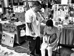 Neck pain !! (-Faisal Aljunied-) Tags: blackandwhite monochrome singapore crash streetphotography his ricohgr treatment neckpain bwstreetphotography traditionalmedicines chinesephysician albertcenter faisalaljunied