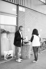 Minolta Hi-Matic G - Couple at the Mall (Kojotisko) Tags: bw streetphotography brno creativecommons czechrepublic streetphoto vx400 konicamonochromevx400 minoltahimaticg konicamonochrome