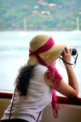 Looking for Mr Goodbar (Brian 104) Tags: girl lady binoculars searching theshore shipboard hat scarf red