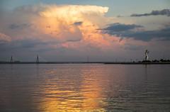 La calma antes de la noche... (Pablin79) Tags: bridge light sunset sky water argentina colors statue clouds reflections river afternoon outdoor peaceful calm misiones posadas