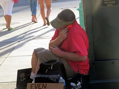 #homelessman uses his Iphone in between begging for money. (kennethkonica) Tags: street city red people urban usa america canon walking movement midwest sitting shadows random grim outdoor expression candid indianapolis seat streetphotography indy talk indiana sunny sit persons seated moods begging panhandler beg global hoosiers canonpowershot iphone marioncounty