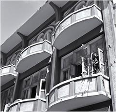 Balcones Sanjuaneros (San Juan Balconies) (Black and White Fine Art) Tags: china bw 6x6 oldsanjuan bn sanjuan balconies 75 viejosanjuan balcones kodaktrix400 kodakd76 75mmf35 eastar
