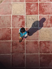 Orange Peel (Feldore) Tags: above street boy shadow red orange peeling candid burma olympus palace aerial panasonic tiles viewpoint burmese mchugh mandalay tiled em1 35100mm feldore
