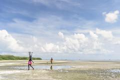 Long walk (Vinith GR) Tags: life travel sea people india colors clouds fishing fisherman ngc culture sunny coastal tamilnadu hardlife dhanushkodi colorsofindia flickrtravelaward environmetalportrait vinithgrphotography