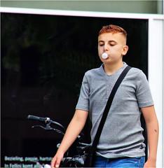 Bubble Gum Kid (Hindrik S) Tags: bubblegum chewinggum kauwgom boy jongen jonge lad people balloon ballon mensen minsken candid street strjitte straat streetphotography straatfotografie city sonyphotographing sony sonyalpha a57 57 slta57 tamron tamronaf16300mmf3563dillvcpzdmacrob016 16300 tamron16300 stad std ljouwert leeuwarden liwwadden 2016